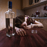 Drunk woman sleeping on the table on kitchen Stock Photography