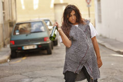 Drunk woman walking in street Stock Images