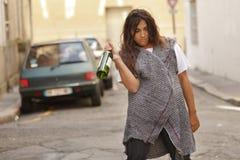 Drunk woman walking in street Stock Images