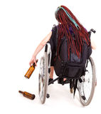 Drunk woman on the wheelchair Stock Photography