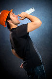Drunk workman with bottle Royalty Free Stock Images