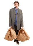 Drunk young  businessman with paper bags Royalty Free Stock Photo