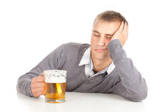 Drunk young man with beer Stock Image