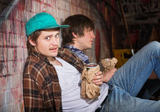 Drunk Young Men. Two drunk young European men sitting outside Stock Photography