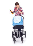 Drunk young mother with baby pram. Drunk young mother with baby buggy (stroller), white background Royalty Free Stock Image