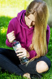 Drunk young woman with bottle of alcohol Royalty Free Stock Image