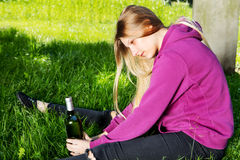 Drunk young woman with bottle of alcohol Royalty Free Stock Photo