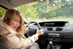 Drunk young woman driving car Stock Image