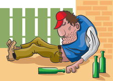 Drunkard. The adult man lies on the street in an unconsciousness and near him are empty bottles from under alcohol Royalty Free Stock Image