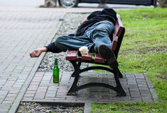 Drunkard on bench Royalty Free Stock Photography