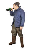 Drunkard is drinking from a bottle Royalty Free Stock Photos