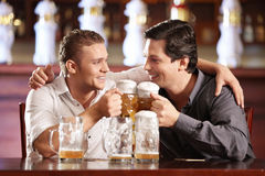 Drunken cheerful man in a pub Stock Images