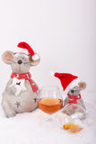Drunken christmas mice with empty cognac glass Stock Photos