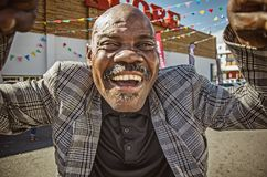 A drunken funny african man Stock Photography