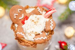Drunken Gingerbread cookie man in a Christmas cocktail Stock Photo
