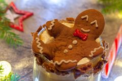 Drunken Gingerbread cookie man in a Christmas cocktail Royalty Free Stock Images