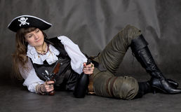 Drunken girl - pirate with pistol and bottle. Drunken girl - pirate on black with pistol and bottle Royalty Free Stock Photo