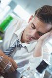Drunken man sleeping on a bar counter Stock Photo