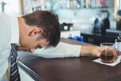 Drunken man sleeping on a bar counter Royalty Free Stock Photography