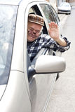 Drunken old man driving a car Royalty Free Stock Photo