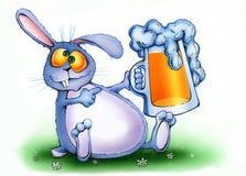 Drunken rabbit with a mug of beer Stock Images