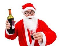 Drunken Santa Claus with wine bottle. Surprised Santa Claus with wine bottle and glass in hand royalty free stock photos