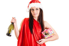 Drunken Santa girl. With a present and bottle of wine Royalty Free Stock Photography