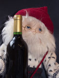 Drunken santa. Homemade santa with a bottle of wine Royalty Free Stock Photo