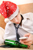 Drunken Teenager in Santa Hat Stock Photo