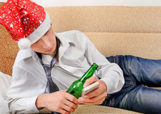 Drunken Teenager in Santa Hat Stock Image