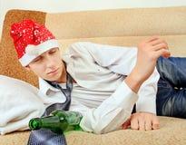 Drunken Teenager in Santa Hat Royalty Free Stock Photography