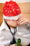 Drunken Teenager in Santa Hat Royalty Free Stock Photography