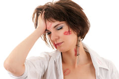 Drunken woman holding a hand behind his head Royalty Free Stock Photo
