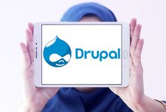 Drupal web framework logo. Logo of Drupal on samsung tablet holded by arab muslim woman. Drupal is a free and open source content-management framework written in Stock Photography