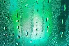 Druppeltjes op glas Stock Afbeeldingen