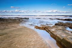 Druridge Bay Rocks. Druridge Bay is a seven mile long beach in Northumberland between Amble to the north and Cresswell to the south Stock Photo