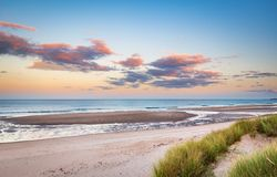 Druridge Bay Sandy Beach near sunset. Druridge Bay is a seven mile long beach in Northumberland between Amble to the north and Cresswell to the south royalty free stock photography