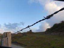 Drut kolczasty w diunach Obrazy Stock