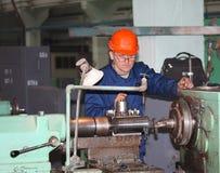 Druzhkovka, Ukraine - December 25, 2012: Turner in the workplace. Druzhkovka Heavy Engineering Plant Stock Image