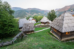 Drvengrad in Serbia. Wooden cottage houses in traditional Drvengrad village, Serbia royalty free stock images