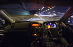 Motorway chase. Drving fast after a car on motorway at night Stock Image