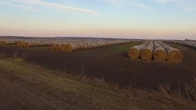 Drving past a landscape full of haystacks. A mounted gopro shot ot a car as it runs on the open road stock video footage