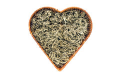 Dry Absinth wormwood medical herbs in heart form basket isolated Royalty Free Stock Photo
