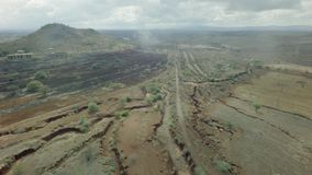 Dry African river bed aerial flyover shot with train tracks in dry season stock video