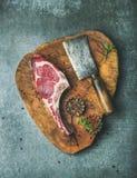 Dry aged raw beef rib eye steak on board Stock Photo