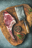 Dry aged raw beef rib eye steak with spices Royalty Free Stock Photo