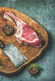 Dry aged raw beef rib eye steak on wooden board Royalty Free Stock Images