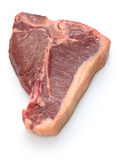 Dry aged t-bone steak, raw beef. Isolated on white background Royalty Free Stock Photo