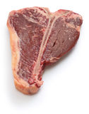 Dry aged t-bone steak, raw beef. Isolated on white background Royalty Free Stock Images