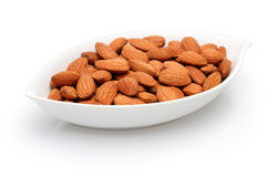 Bowl full of almonds. Dry almonds in a white bowl, a isolated on white Royalty Free Stock Photo